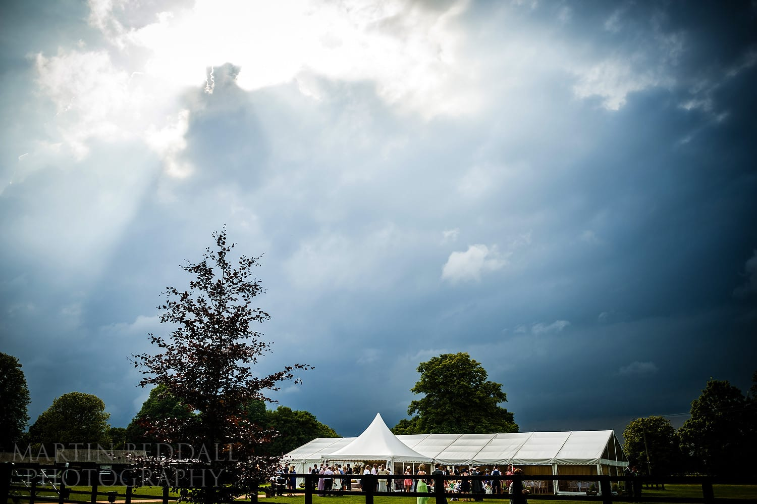 Rainclouds gather over the wedding reception