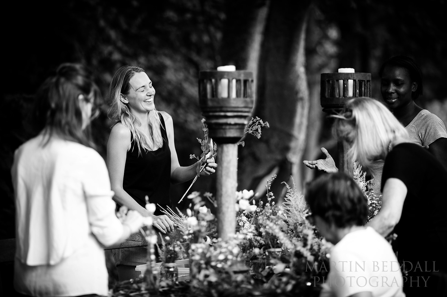 Bride laughs as she works with family and friends