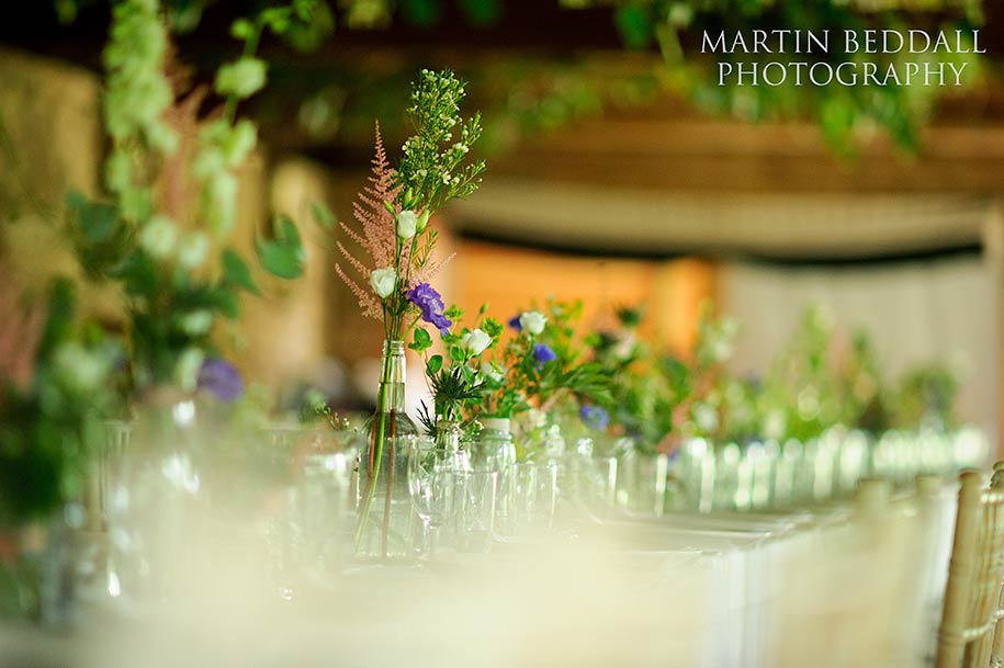 Dining table in the barn at Dewsall court wedding