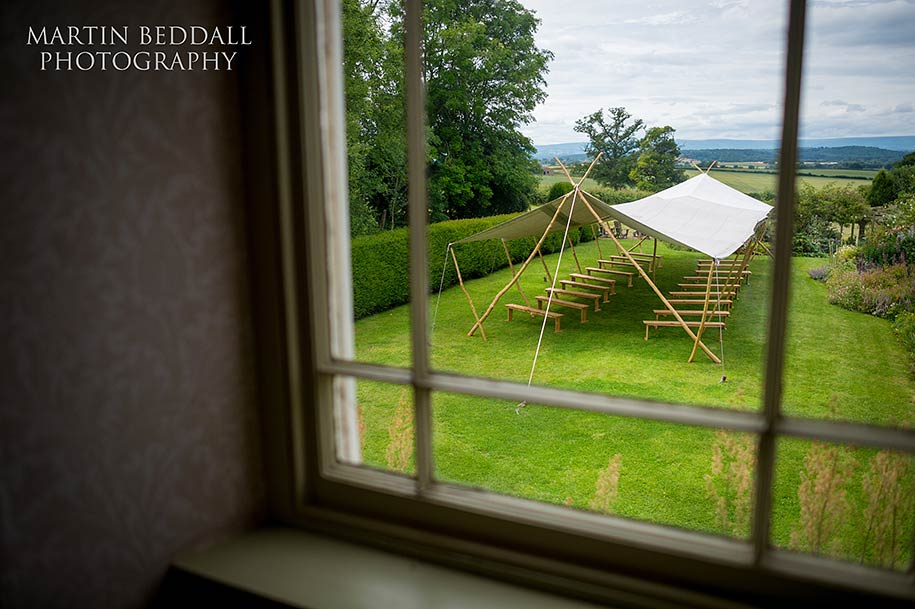 Open air wedding ceremony tent at Dewsall Court