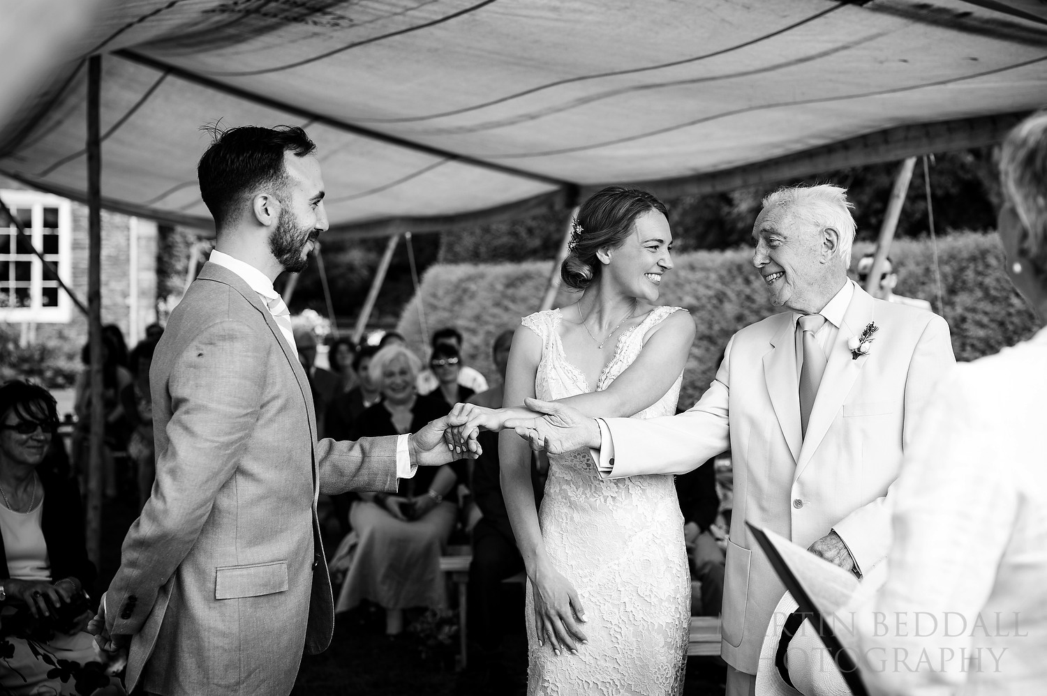 Bride's father gives her away