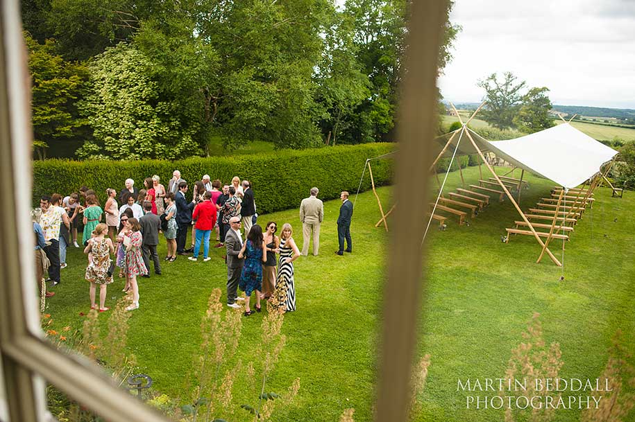 Wedding guests before the ceremony at Dewsall Court