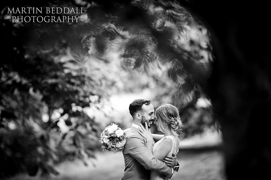 Bride and groom portrait at Dewsall Court