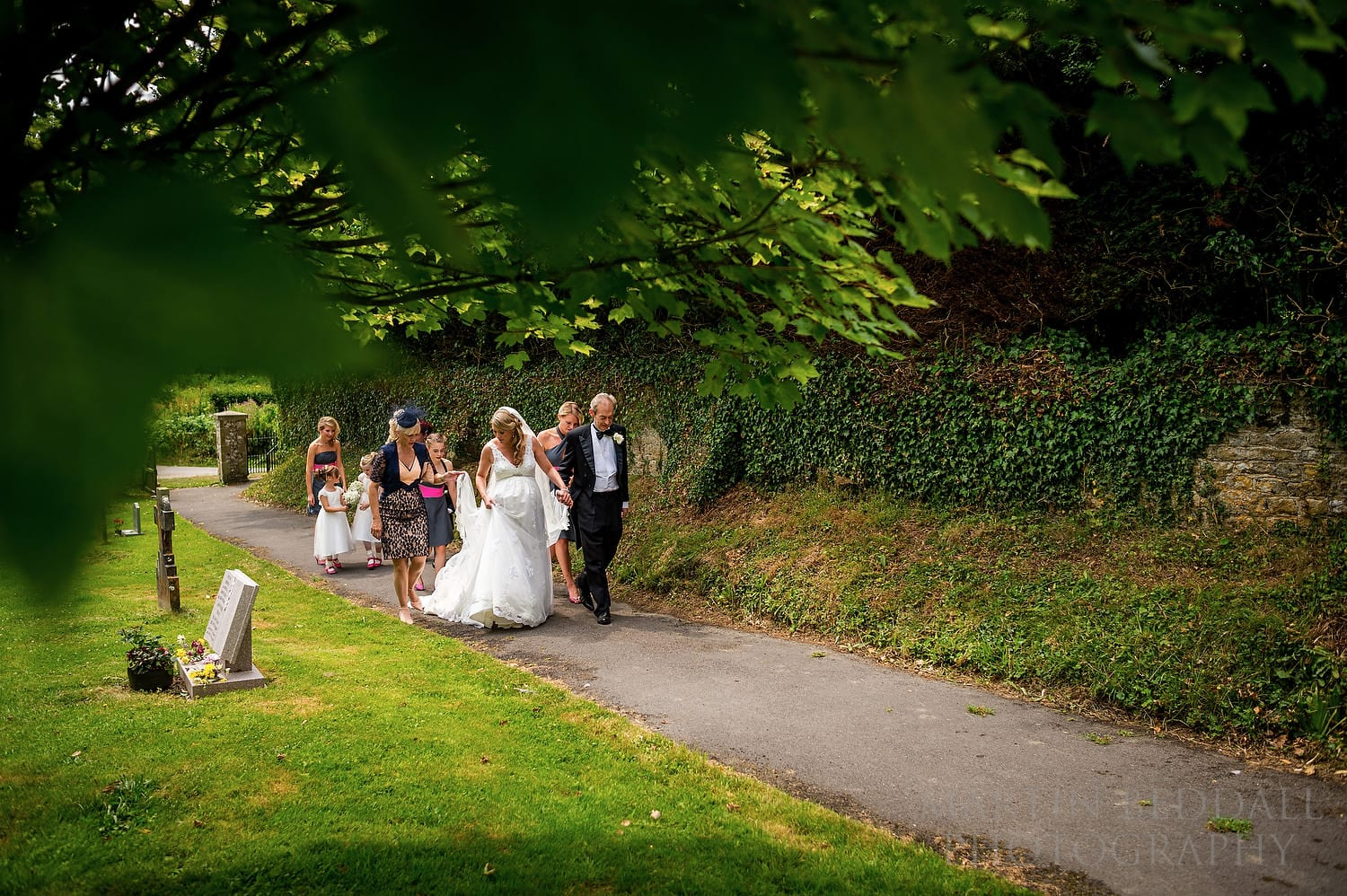 Bride and her father lead the way to St Catherine of Siena church