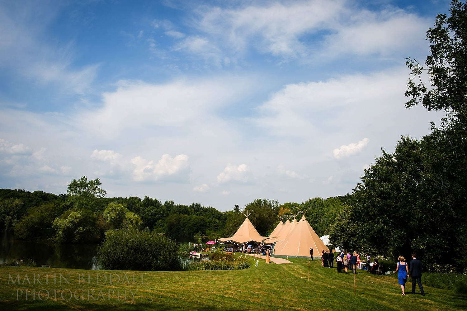 Guests head to the large tipis at Duncton Mill wedding