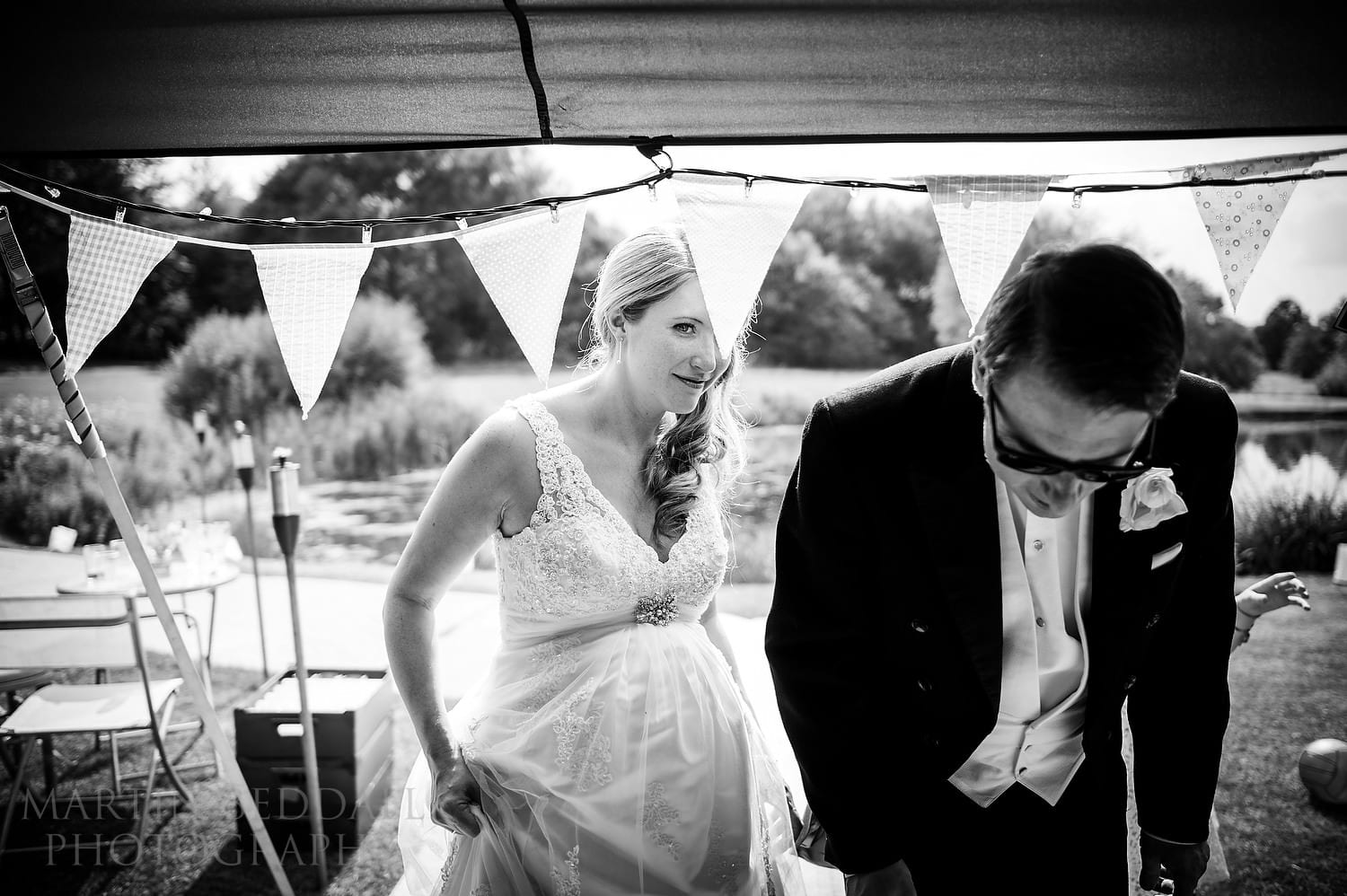 Bride and groom enter the tipi at Duncton Mill