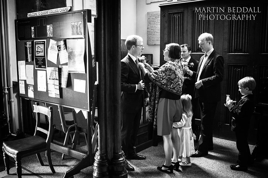 Groom getting ready at Queens' college chapel