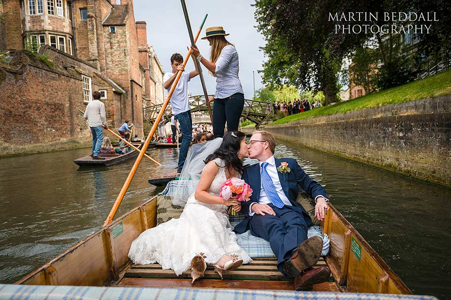 Bride an groom on a punt in cambridge