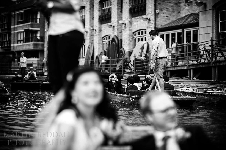 wedding guests on cambridge punts