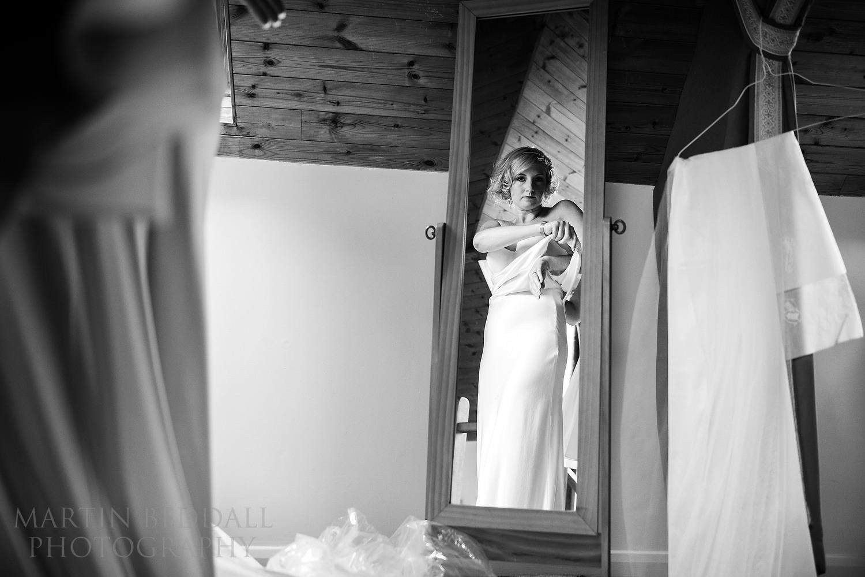 Bride puts on her wedding dress at South Farm wedding