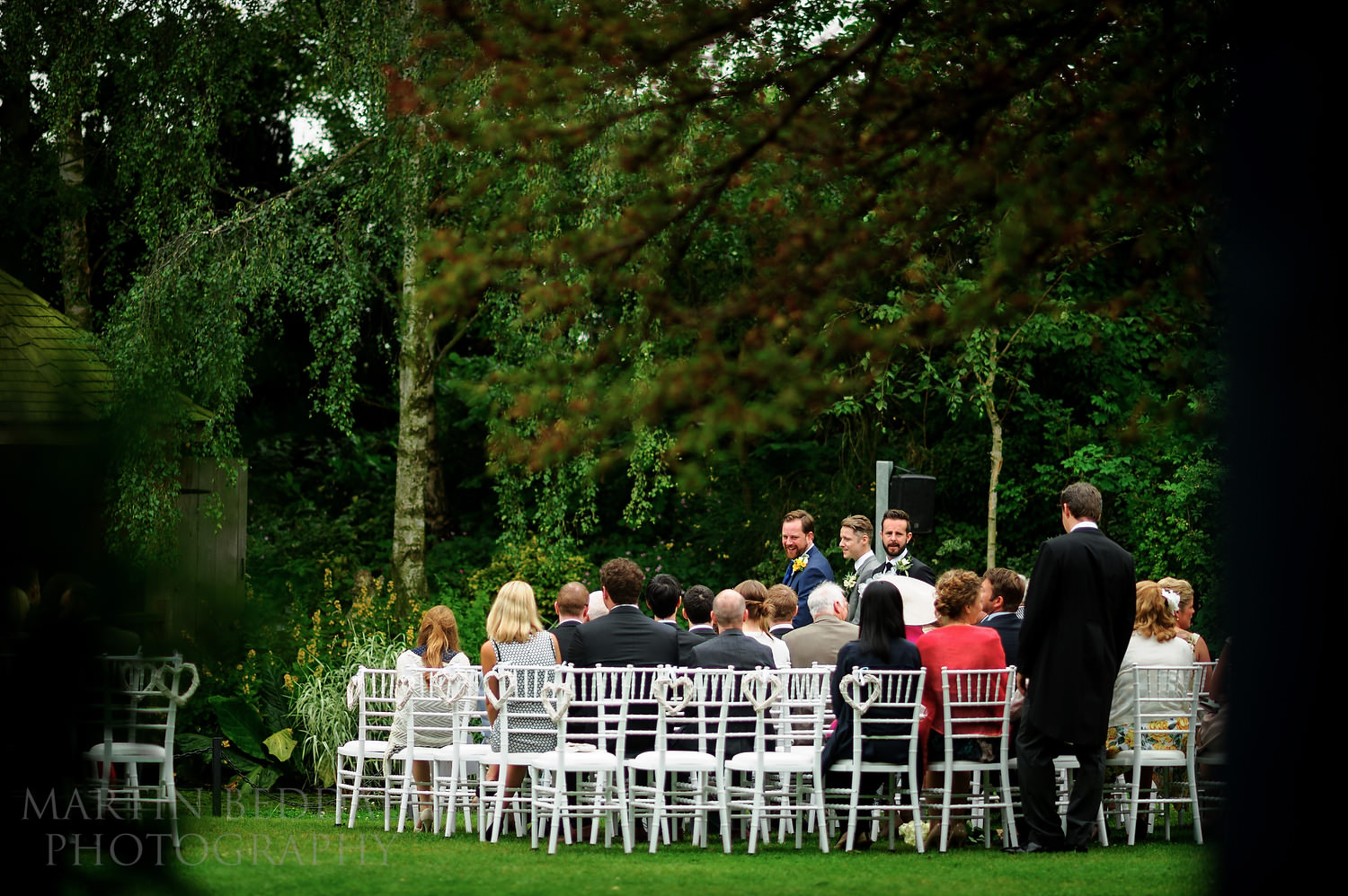 Groom waits with the wedding guests
