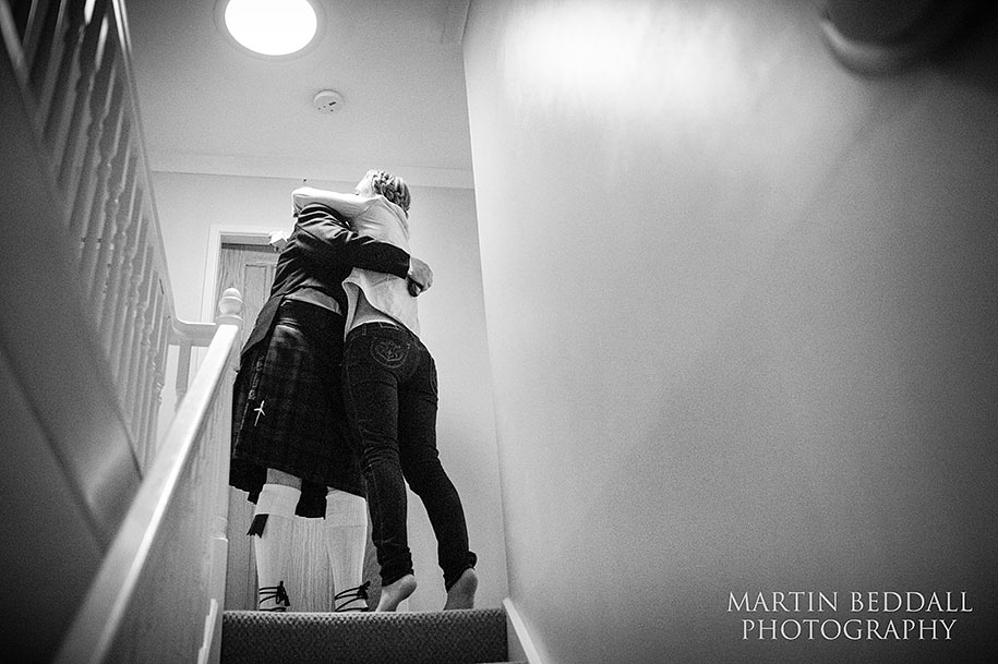 bride shares a hug with her father beore the wedding