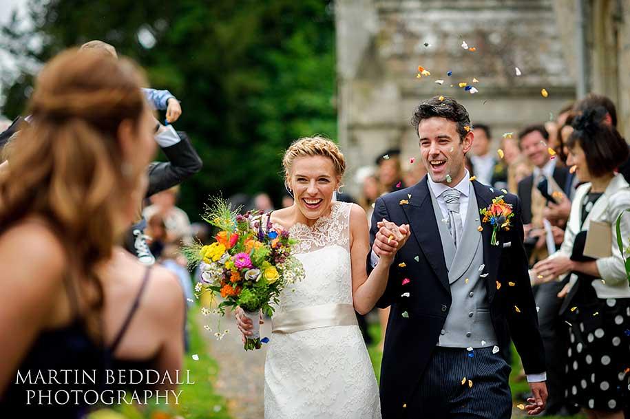 Bride and groom confetti run