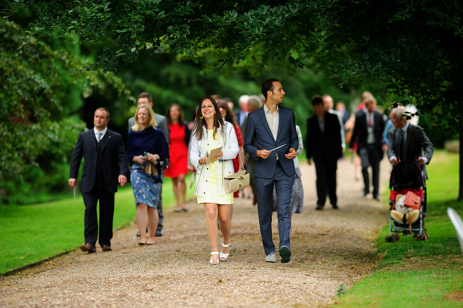 Wedding guests walk to the reception