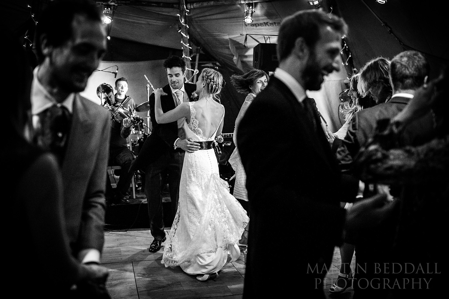 Bride and groom dance in the wedding tipi