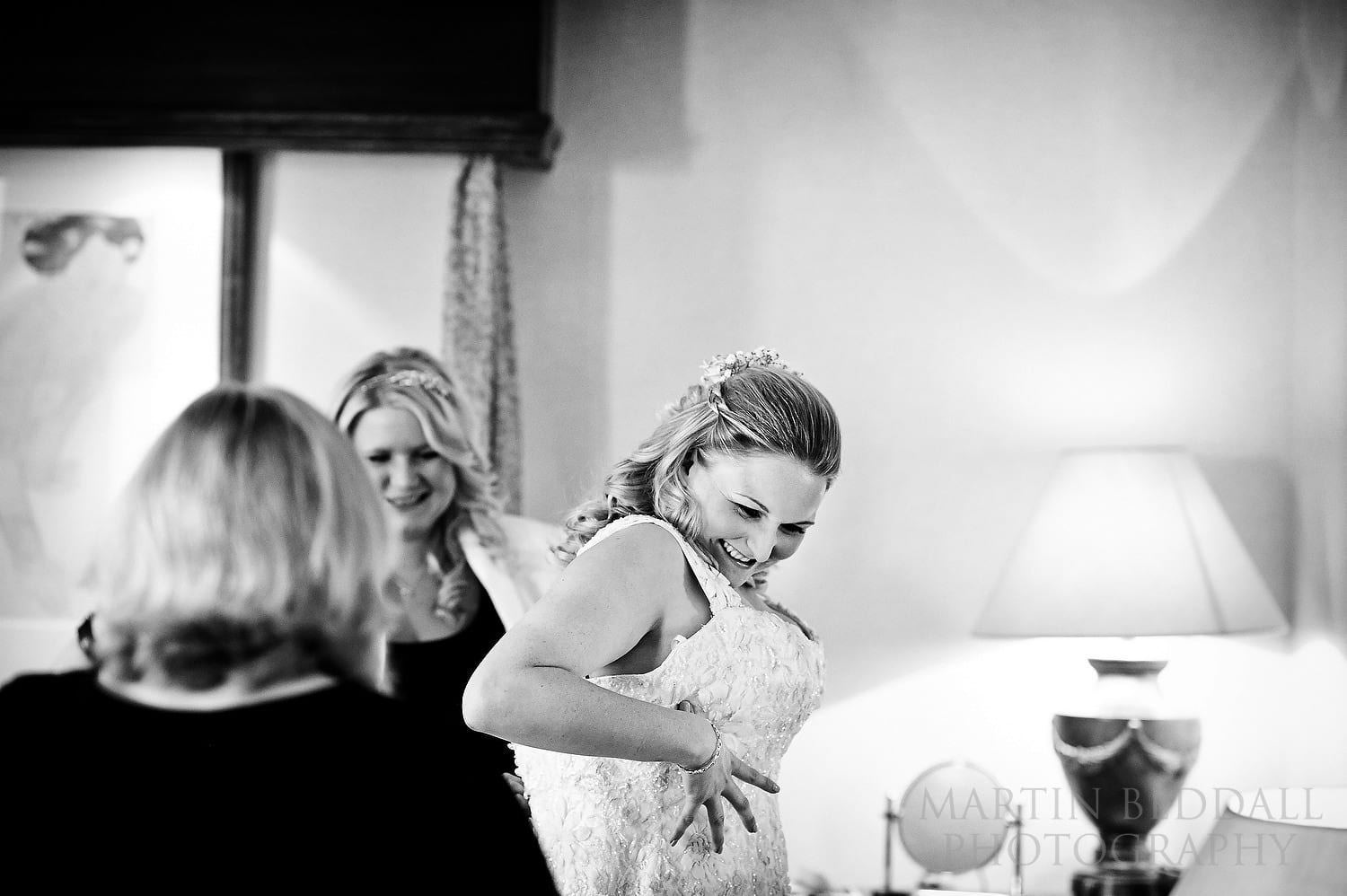 Getting the bride into her wedding dress