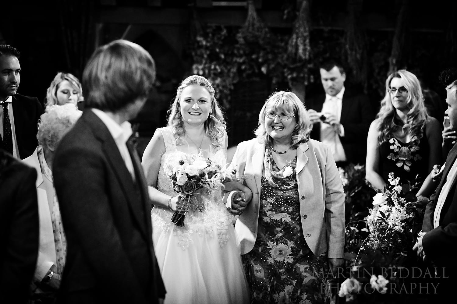 Bride walks up the aisle at Dode with her mother