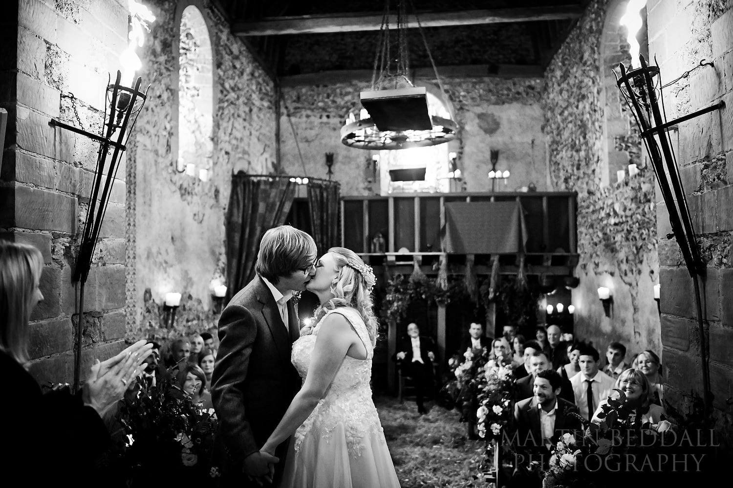 Bride and groom kiss at Lost Village of Dode wedding ceremony