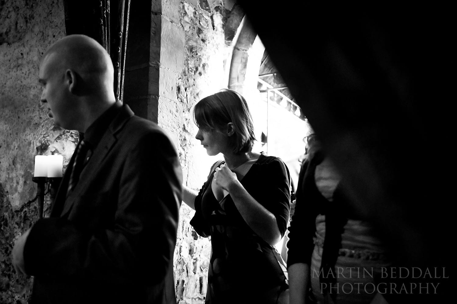 Guests head back into the chapel for the wedding meal