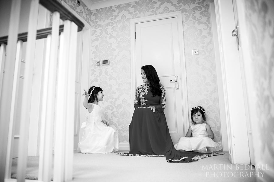 Bride waits at the top of the house with the flowergirls