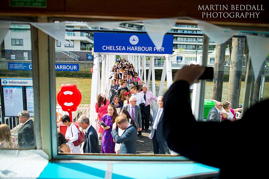 Wedding guests embark at Chelsea Harbour