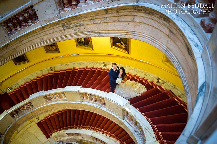 One Whitehall Place bride and groom portrait on the stairs