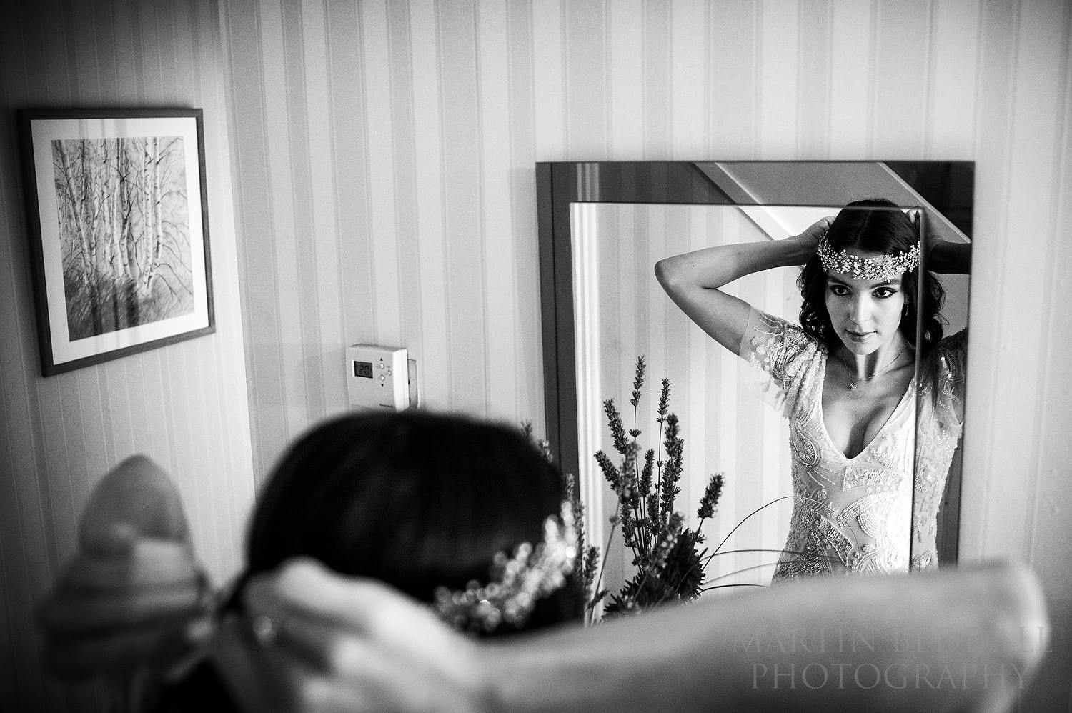 Bride adjusting her Swarovski halo