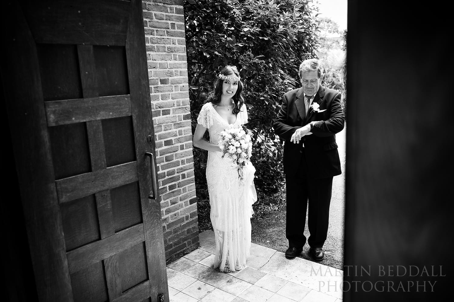 Bride and her father wait at the church door