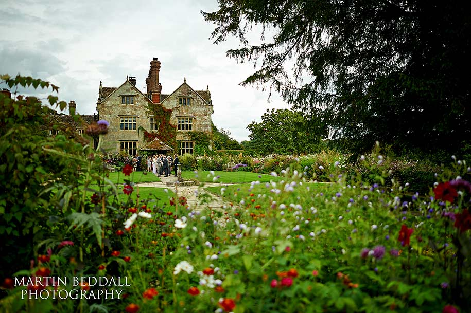 Wedding reception in the flower garden at Gravetye Manor