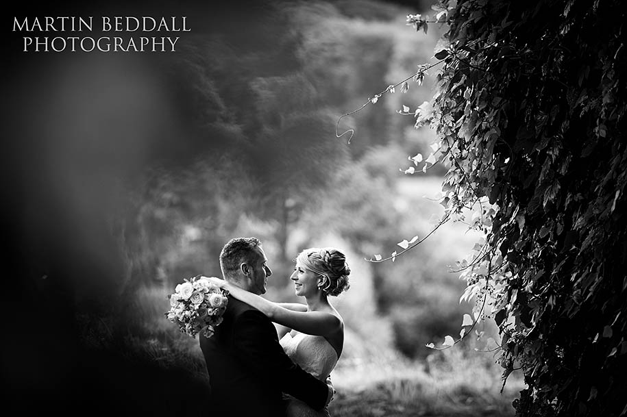 Bride and groom portrait at Gravetye Manor wedding