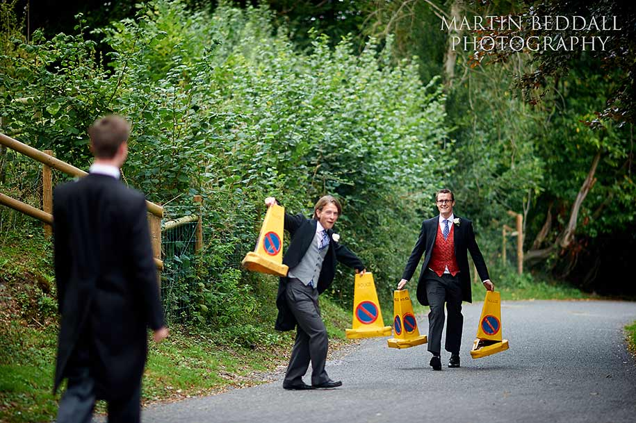 Ushers remove the no parking cones before the bride arrives