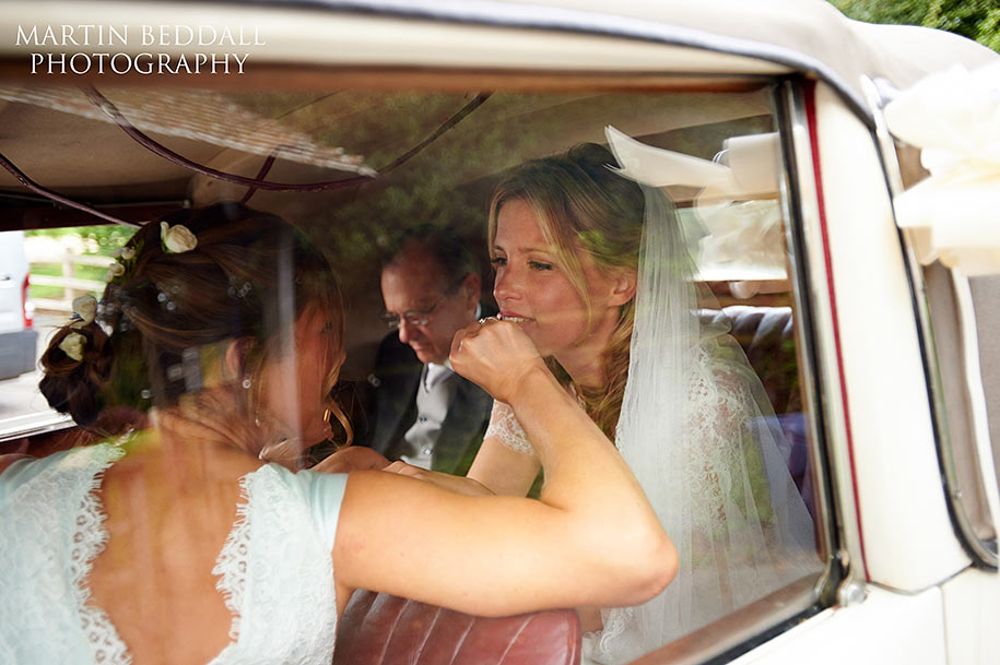 Last minute makeup for the bride in the wedding car