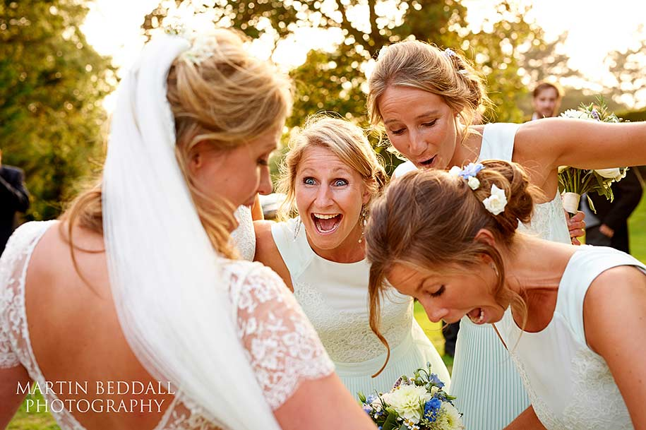 Bridesmaids and the bride laughing