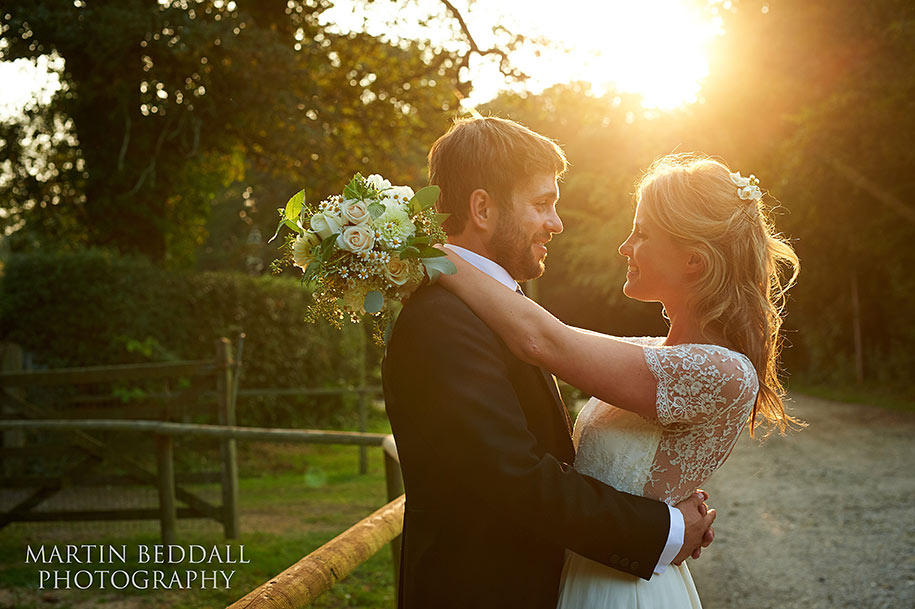 Bride and groom bathed in golden sunlight