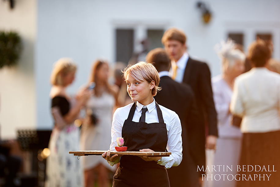 Cute waitress at wedding reception