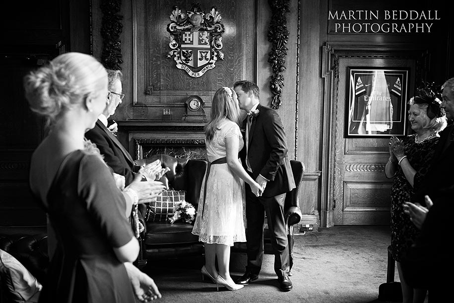 Mayor's Parlour wedding the bride and groom kiss