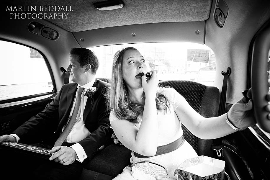 Bride and groom in a London taxi cab