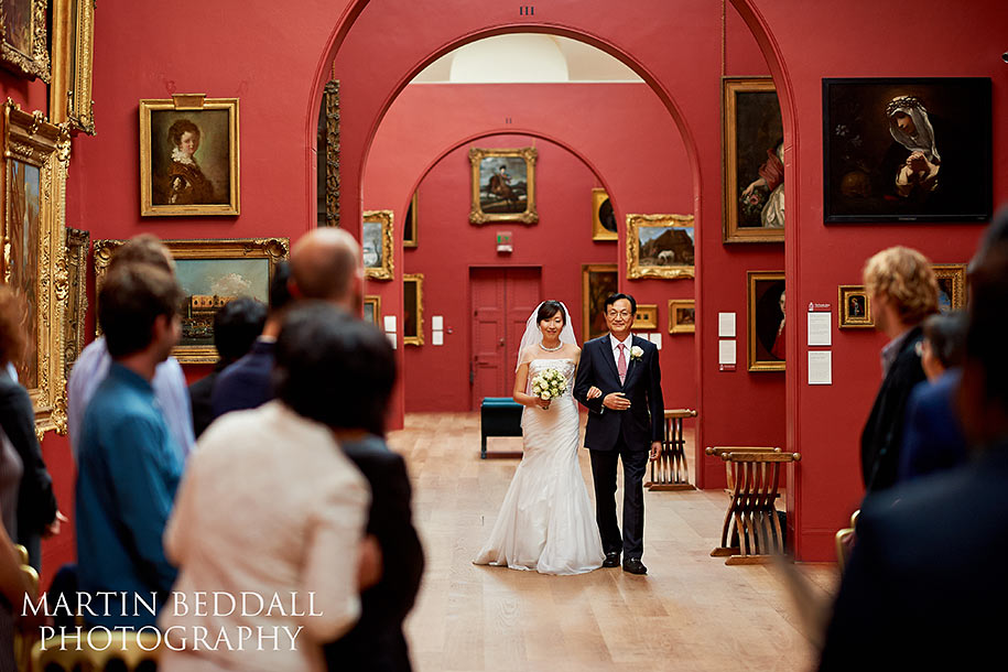 Bride and her father walk down the aisle at Dulwich Picture Gallery wedding