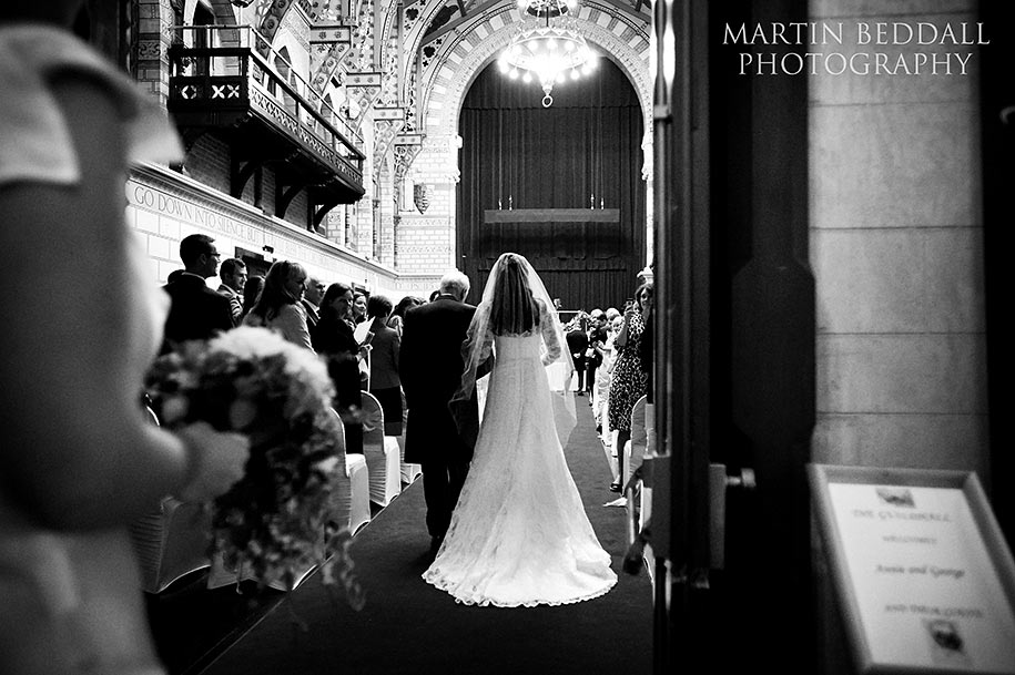 Bride and her father walk up the aisle at Northampton Guildhall