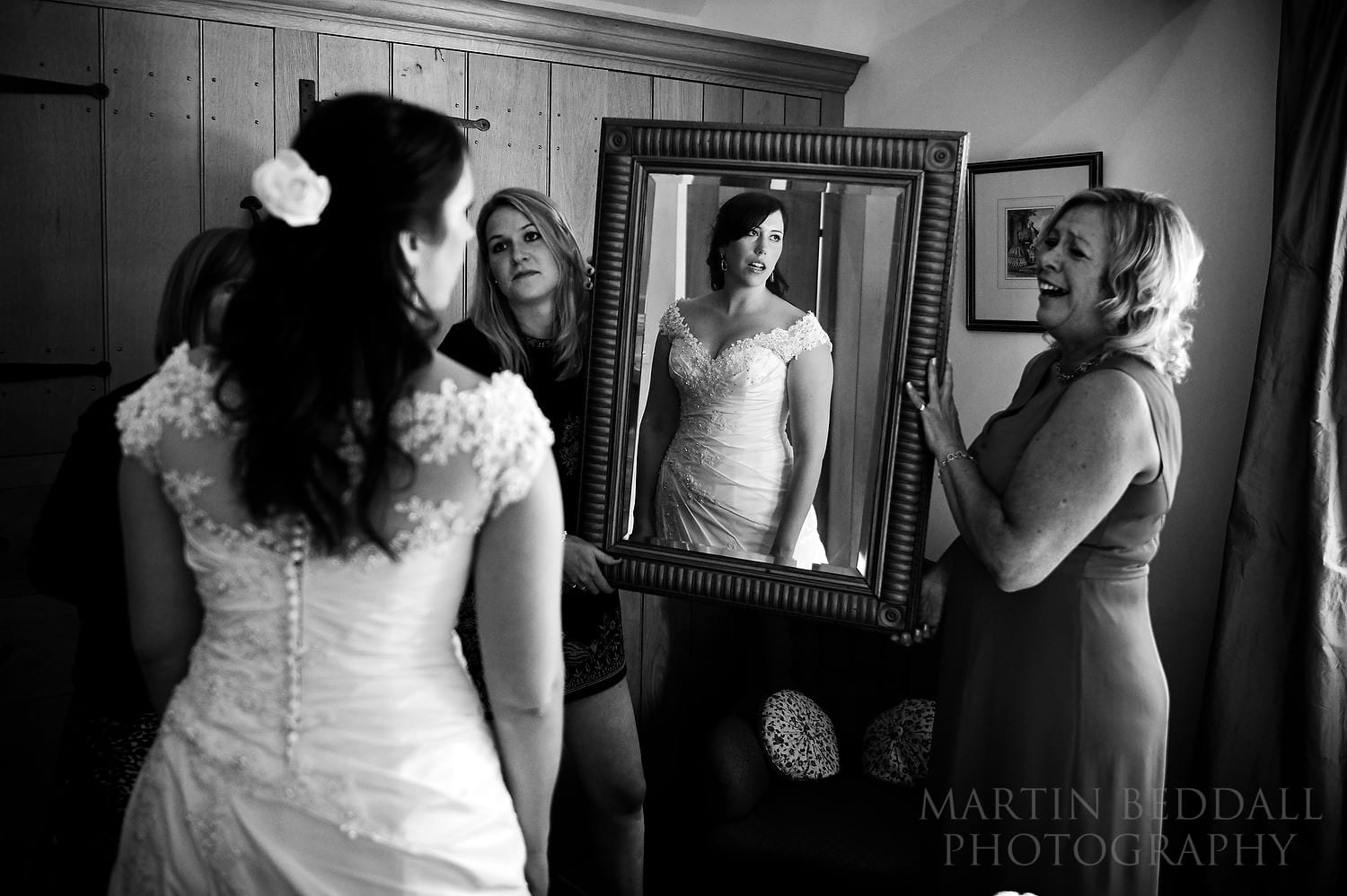 Holding up the mirror for the bride