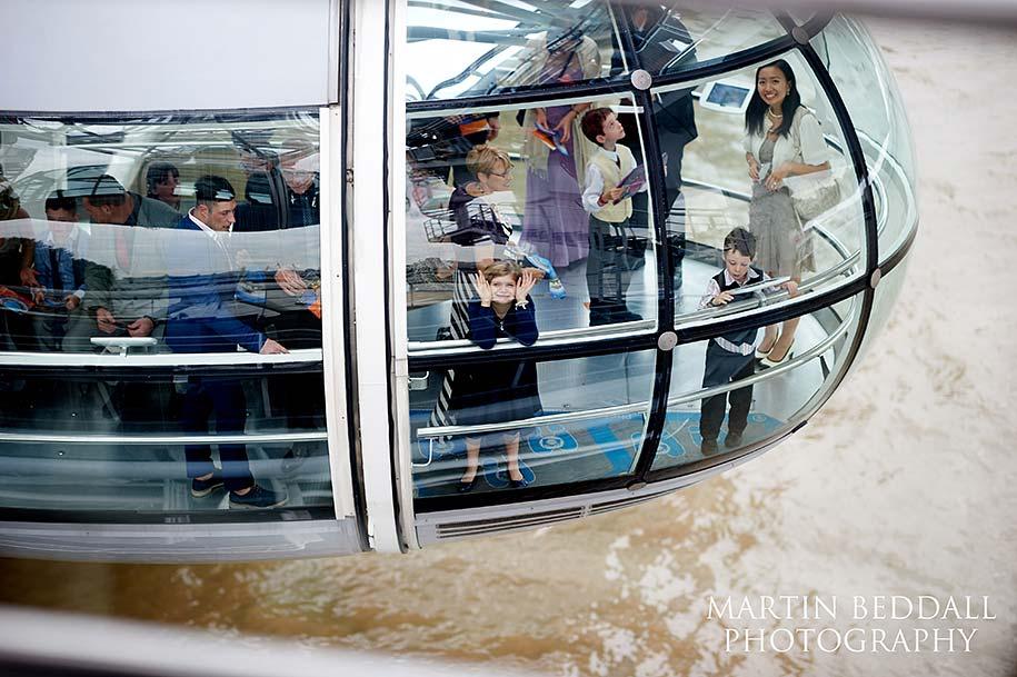 Wedding guests in a London Eye capsule