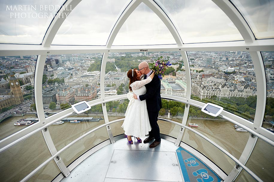 Bride and groom kiss on the London Eye