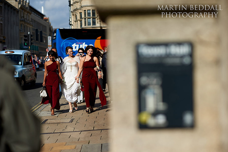 Bride and bridesmaids walk to Oxford Town Hall wedding