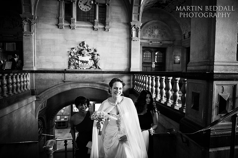 Bride walks up the steps of Oxford Town Hall
