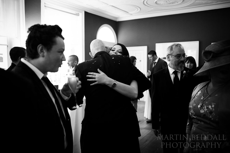 Hug for the groom at Royal Society of Arts wedding