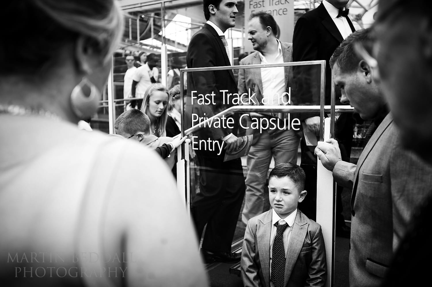 Wedding guests queue to board the London Eye
