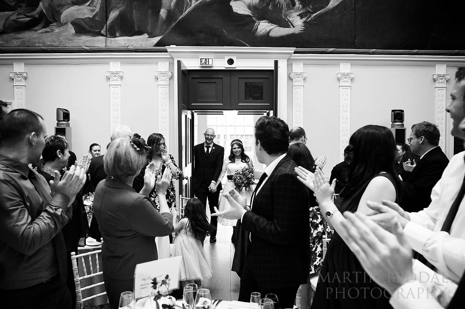 Bride and groom enter the Great Room at The Royal Society of Arts