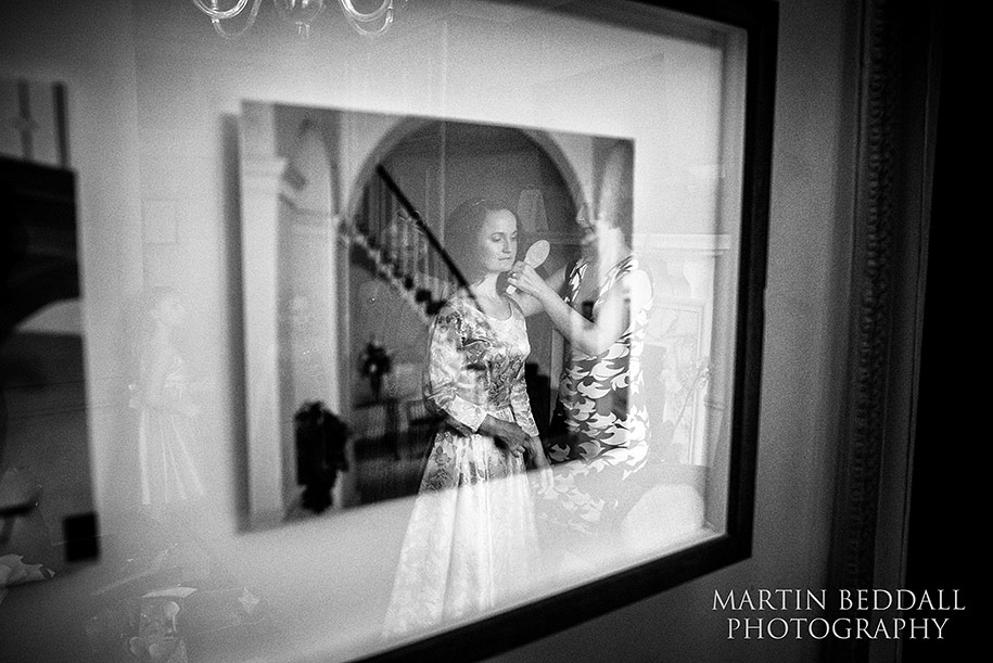 Bride getting ready reflected in a picture