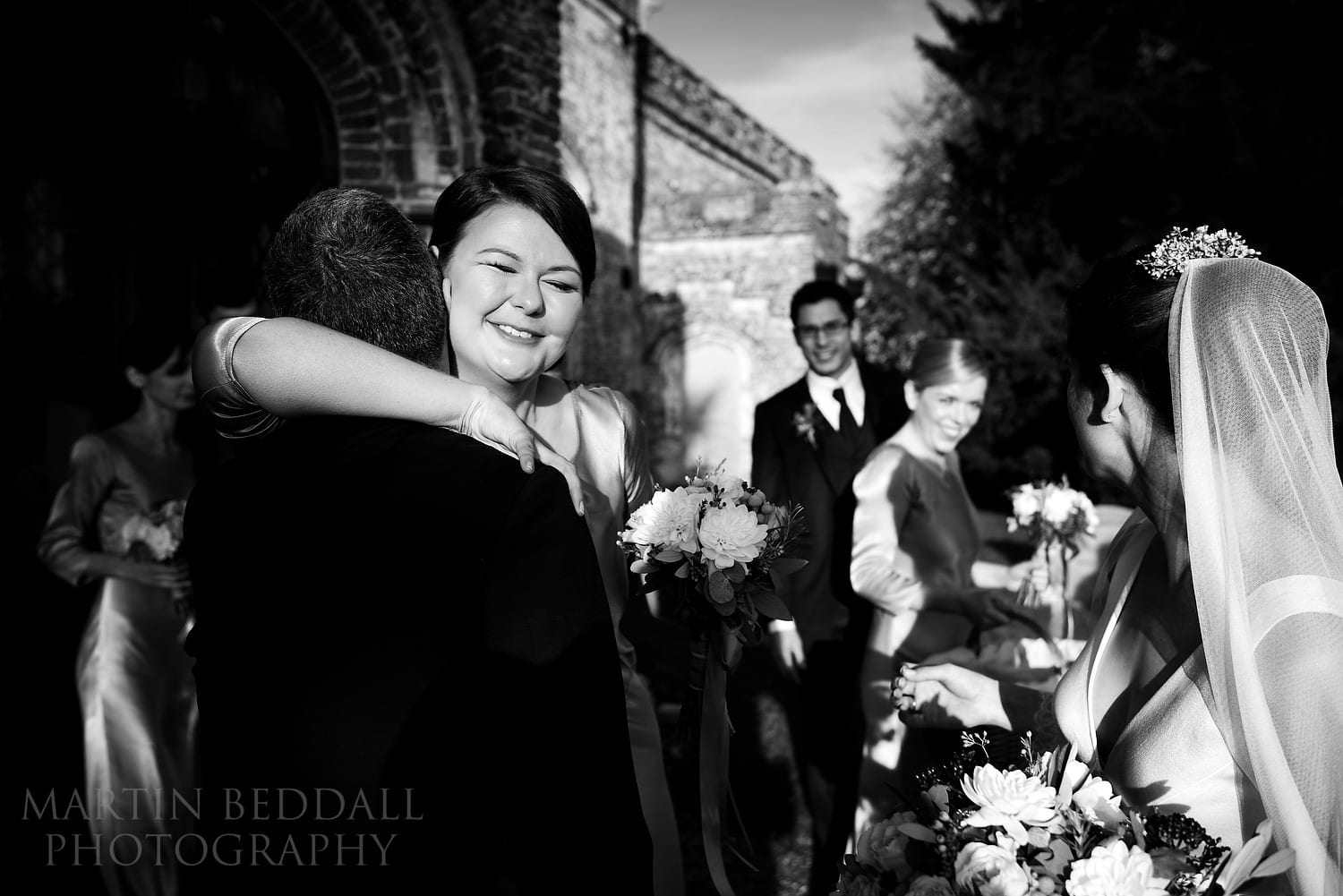 Hugs outside Layer Marney Tower church