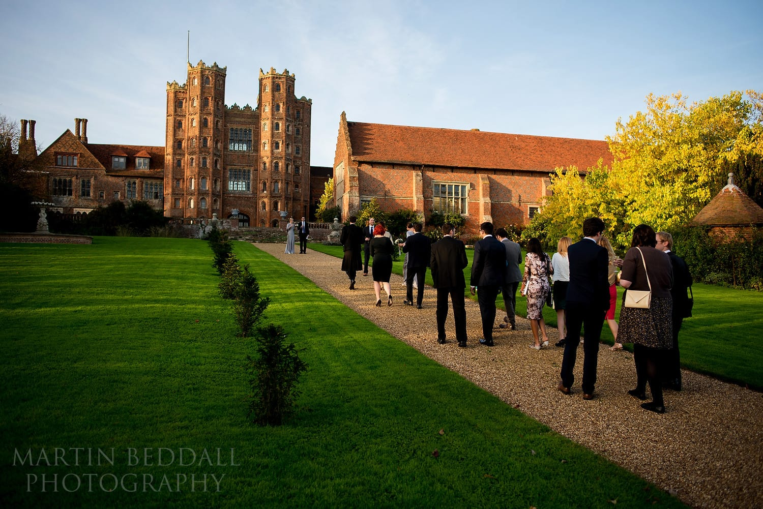 Guests walk to Layer Marney Tower from the church
